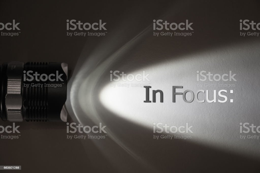 Concept header: In focus. Strong light source from flashlight stock photo