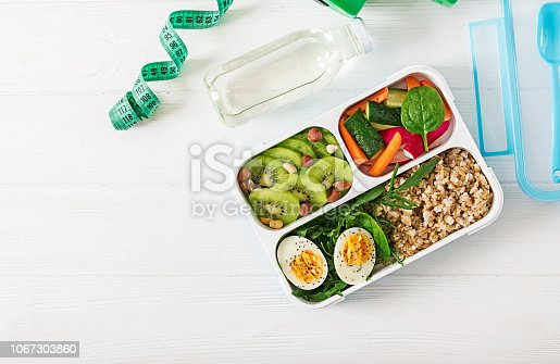 istock Concept healthy food and sports lifestyle. Vegetarian lunch.  Healthy breakfast. Proper nutrition. Lunchbox. Top view. Flat lay. 1067303860