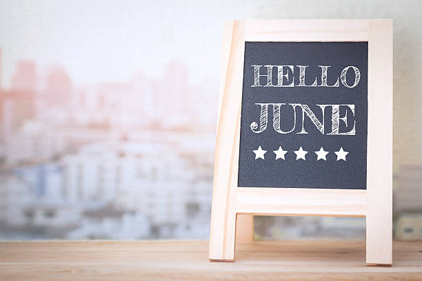 Concept HELLO JUNE message on wood boards stock photo