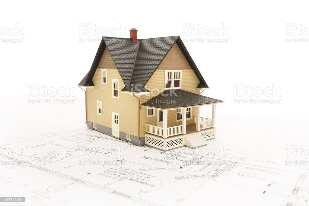 Concept house sitting on blueprints series stock photo