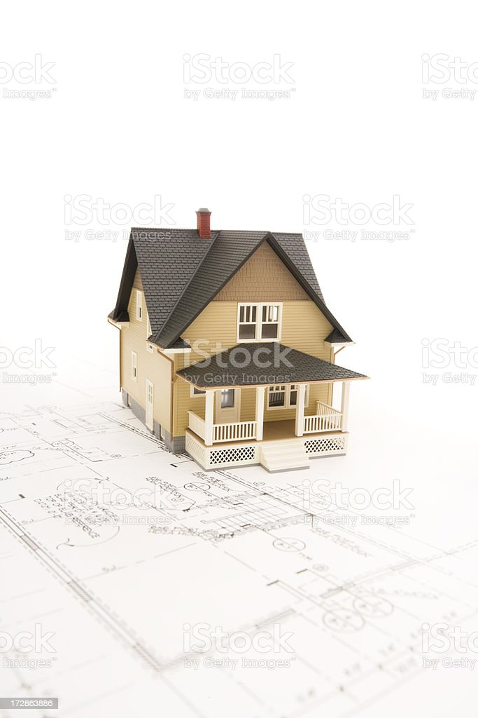 Concept house sitting on blueprints series royalty-free stock photo