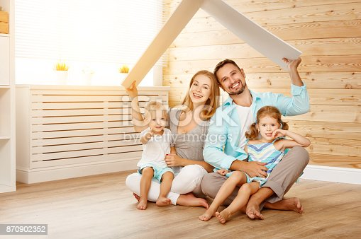 921362094istockphoto concept housing a young family. mother father and children in  new home 870902352