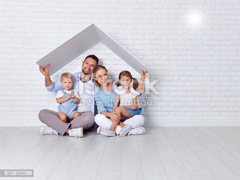 istock concept housing a young family. mother father and children in  new home 910872286