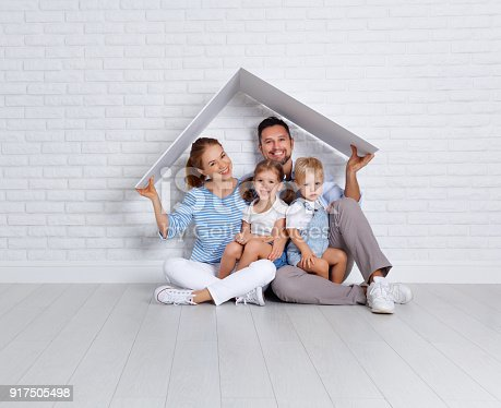 istock concept housing a young family. mother father and children in  new home 917505498