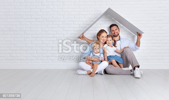 istock concept housing a young family. mother father and children in  new home 921359736