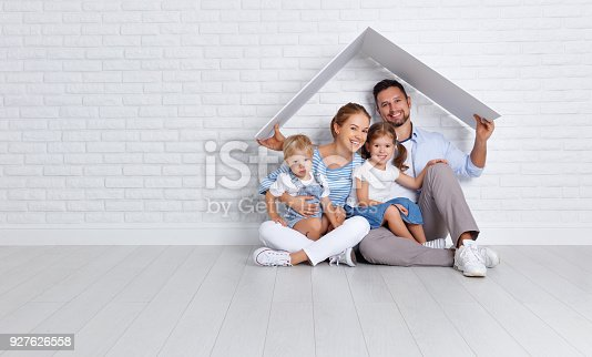 istock concept housing a young family. mother father and children in  new home 927626558