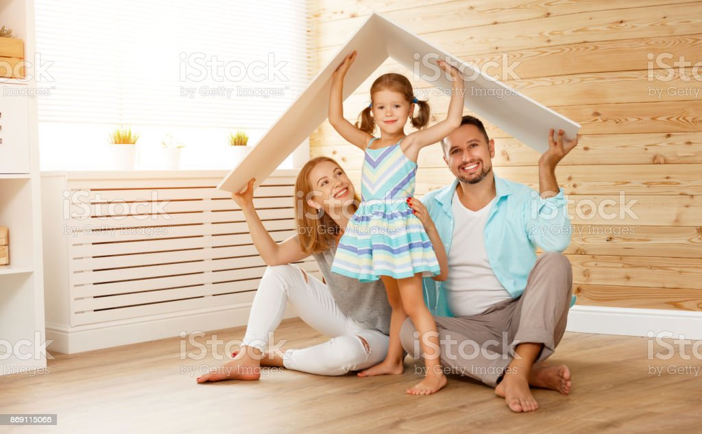 concept housing   young family. Mother father and child in new house with  roof royalty-free stock photo