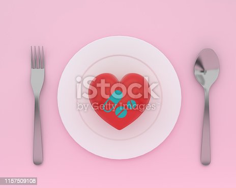 917079152istockphoto Concept idea about of health and medical insurance, Creative idea of heart on plate with spoons and forks with icon healthcare medical on pink color background. 1157509108