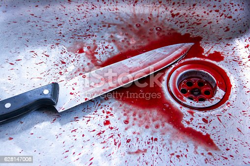 Concept image of a sharp knife with blood in sink background.kill concept.Murder concept