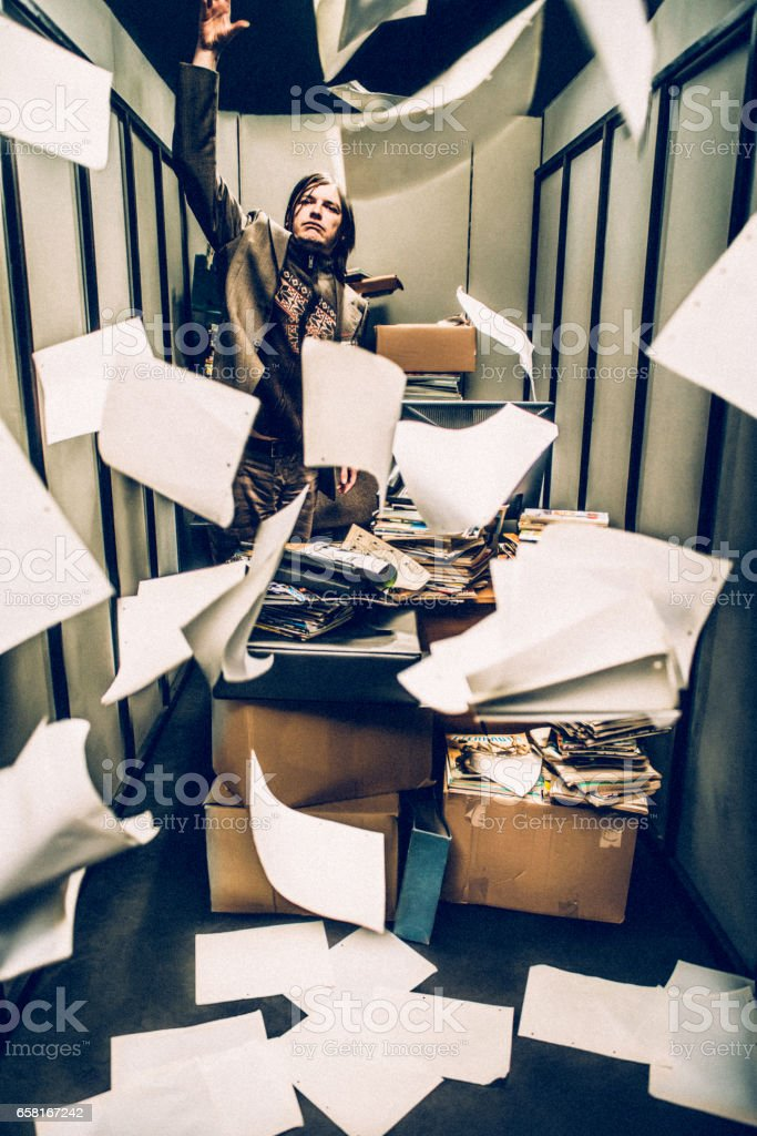 Concept image of a Stressful Day in a Tiny Office stock photo