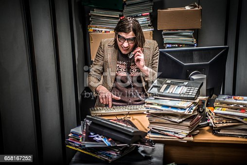 Concept image of a Stressful day in a tiny Office of a Magazine editor