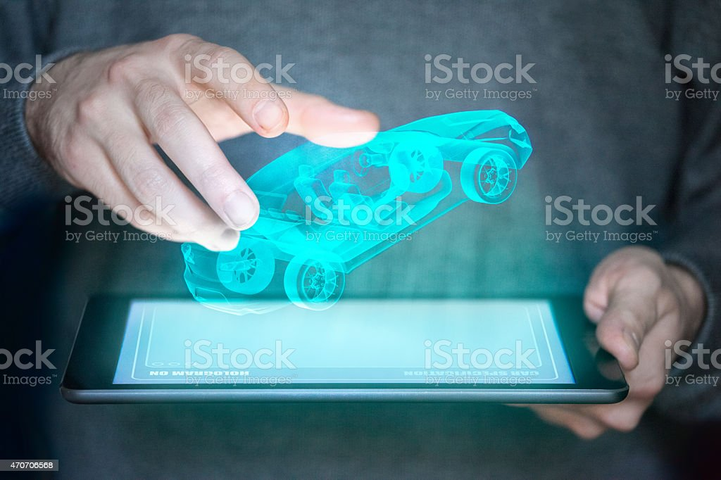 Concept image of a tablet who projects a car stock photo