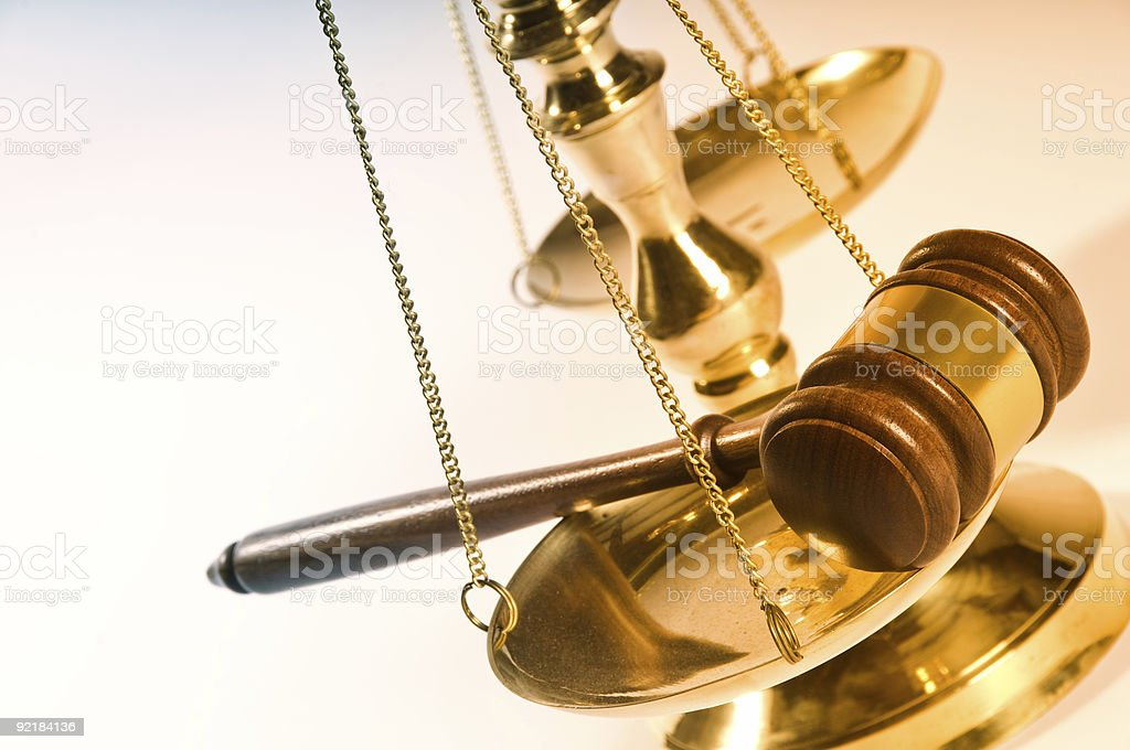Concept image of justice with a balance and gavel royalty-free stock photo