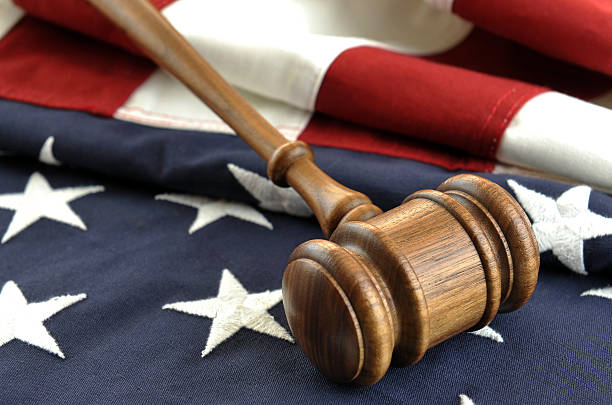 Concept image of justice with USA flag and wooden gavel stock photo