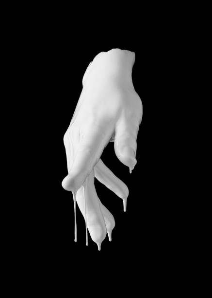 concept image of white paint dripping on female hand stock photo