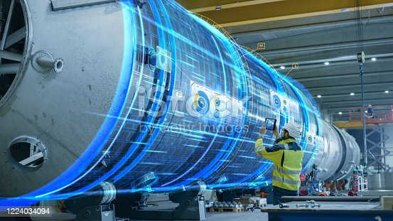 AR Concept: Industrial Engineer Uses Augmented Reality Digital Tablet to Scan Large Metal Construction, Special Effects Show Visualization / Digitalization of Oil, Gas and Fuel Transport Pipeline.