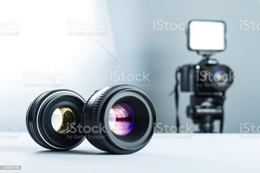 Concept interview and video production, wireless microphone and video camera (DSLR camera) in the studio on a white background. stock photo