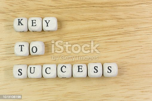 istock concept key to success on  wood cube for background. 1073106198
