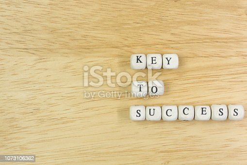 istock concept key to success on  wood cube for background. 1073106362