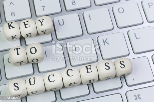 istock concept key to success on  wood cube for background. 1073106502