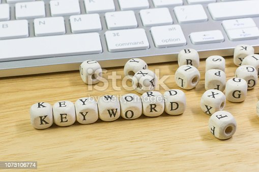 istock concept Keyword on  wood cube for background. 1073106774