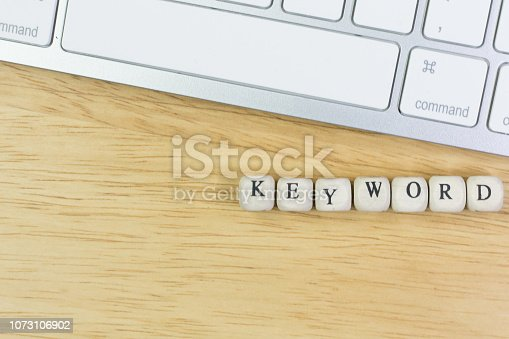 istock concept Keyword on  wood cube for background. 1073106902