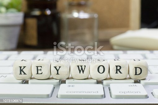 istock concept Keyword on  wood cube for background. 1073106974