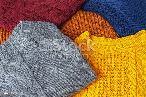 Concept knitted wool colorful warm sweaters closeup