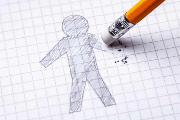 コンセプトです。手の切断の損失。消去の手を持つ男の鉛筆でください。 ストックフォト