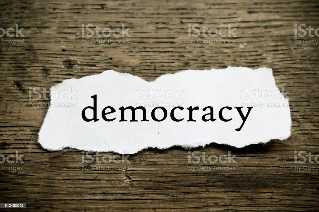 Concept  message on paper - democraty stock photo
