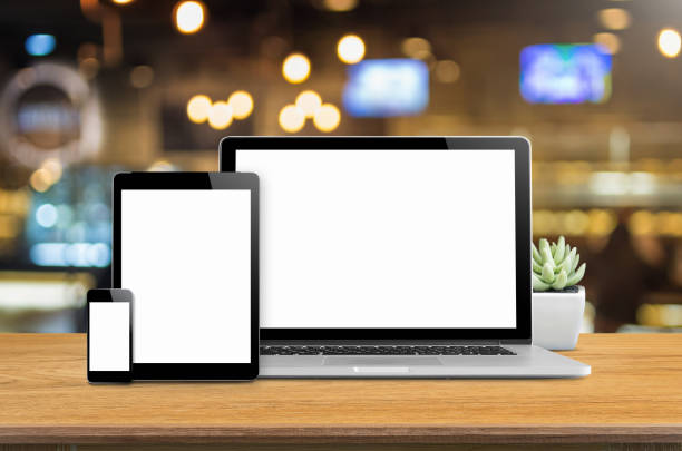Concept mockup. Laptop smartphone and tablet mockup on desk with blurred background. ipad stock pictures, royalty-free photos & images