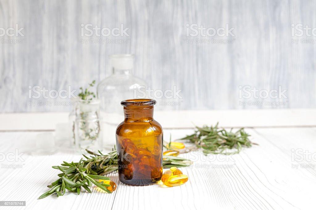 concept - natural medicine herbs in bottles on wooden background photo libre de droits