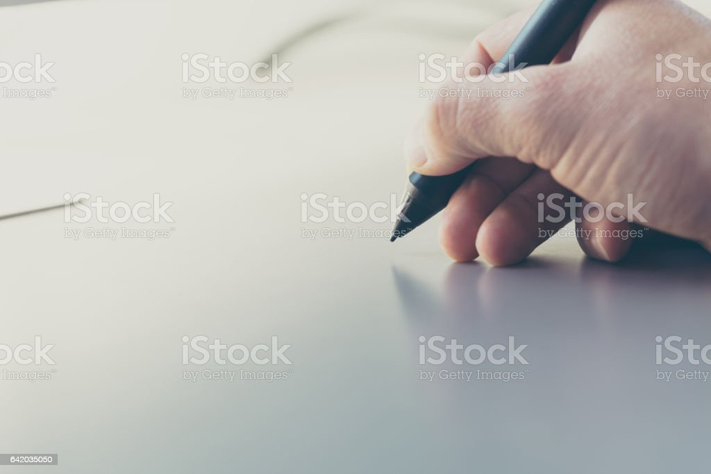 Concept of a digital signature on a tablet in the modern world. stock photo
