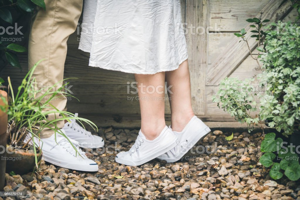 Concept of a romantic love story.Man and woman legs closeup outdoor.Lovers couple on kissing day and hugging each other. zbiór zdjęć royalty-free