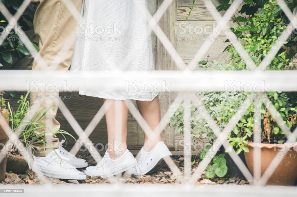 Concept of a romantic love story.Man and woman legs closeup outdoor.Lovers couple on kissing day and hugging each other. royalty-free stock photo
