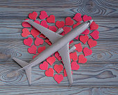 Concept of a romantic trip. A big heart is collected from a small heart and an airplane. honeymoon, valentine's day