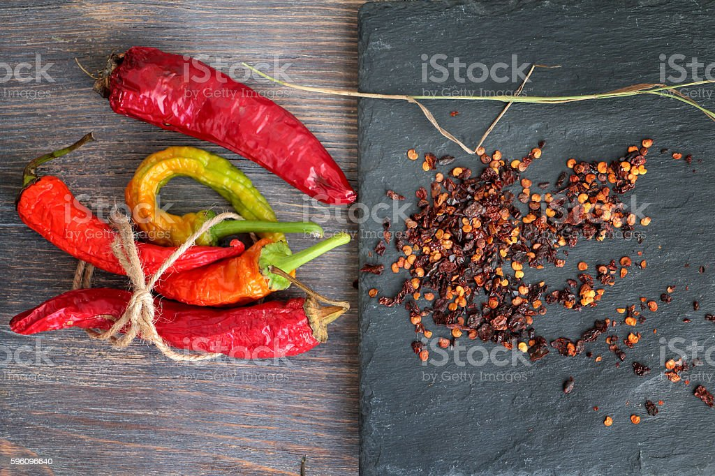 Concept of aging - dry colored chili peppers Lizenzfreies stock-foto