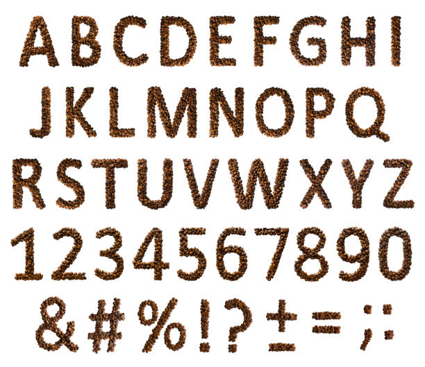 Concept of alphabet, numbers and signs laid out of roasted aromatic coffee beans isolated on a white background. stock photo