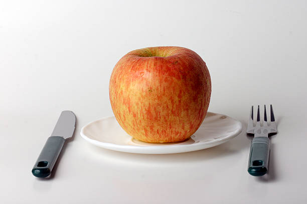 Concept of An apple a day keeps the doctor away stock photo