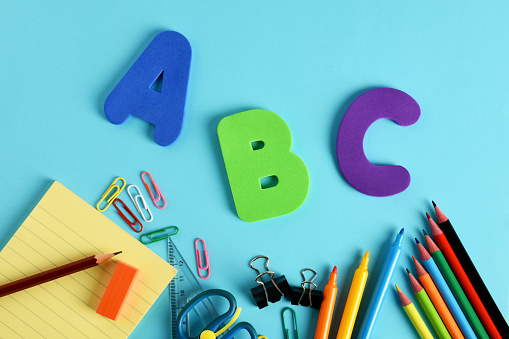 Concept of back to school, letters a,b,c with school supplies with copy space