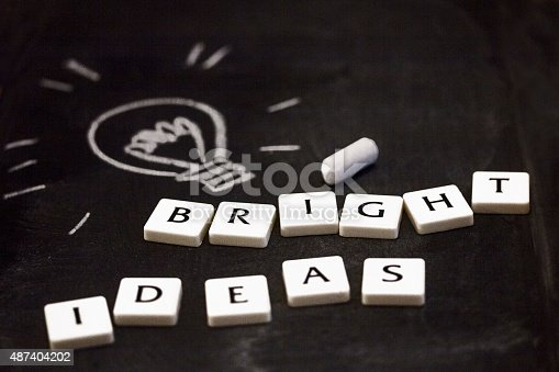 istock Concept of bright ideas. Drawn glowing light bulb on blackboard. 487404202