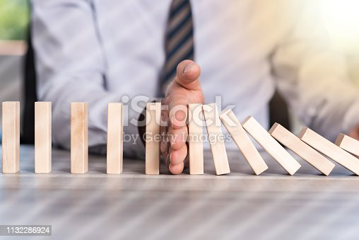 Business control concept by stopping domino effect, light effect