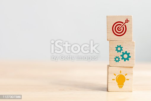 istock Concept of business strategy and action plan. Wood cube block stacking with icon 1127307386
