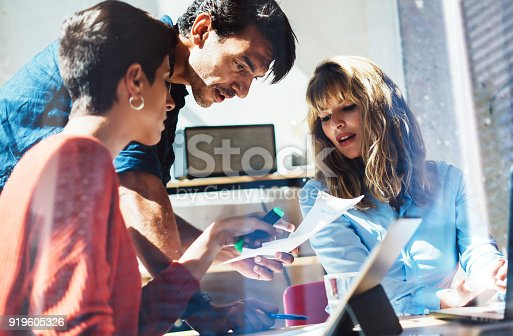 912675036 istock photo Concept of business team at working process.Young professionals work with new market project. Project managers meeting.Blurred background.Horizontal.Cropped. 919605326