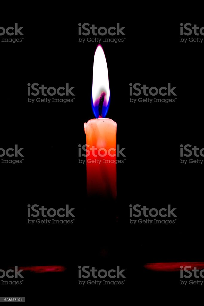 Concept of Candle flame light at night. stock photo