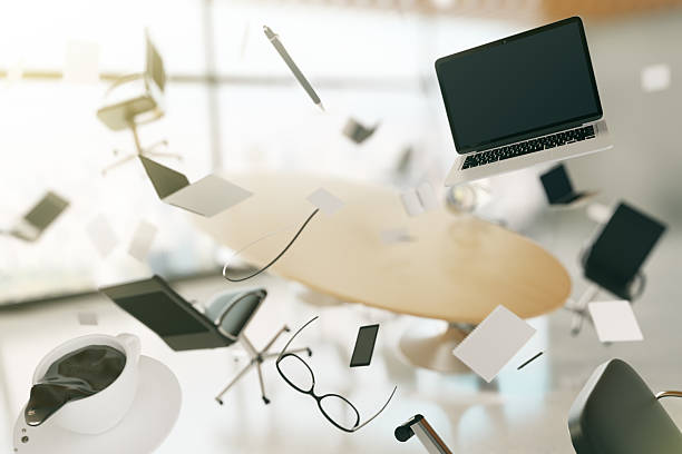 concept of chaos in the office with flying objects - chaos stock pictures, royalty-free photos & images