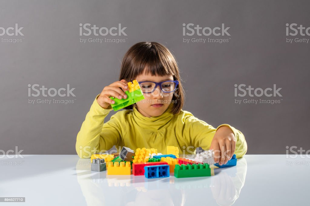 concept of childhood and education with little engineer girl stock photo