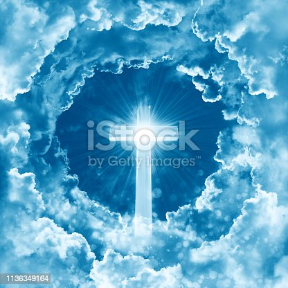 istock Concept of christian religion shining cross on the background of dramatic cloudy sky. Sky with cross and beautiful cloud. Peaceful religious background. Divine shining heaven, light 1136349164