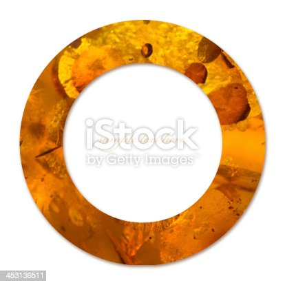 istock Concept of circle with amber texture and empty place 453136511