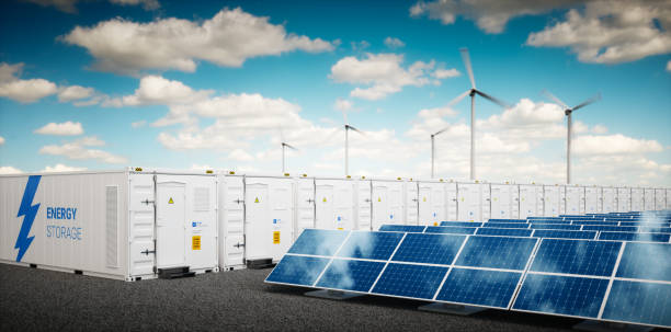 Concept of container Li-ion energy storage system. Renewable energy power plants - photovoltaics, wind turbine farm and  battery container. 3d rendering. stock photo